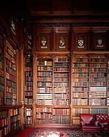 Coats of arms, painted in niches above the bookcases, adorn the walls of the library