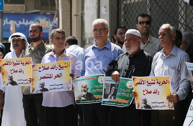 Palestinians hold banners during a protest to show solidarity with  Leader of the northern Islamic Movement Sheikh Raed Salah who is held in Israeli jails  in Gaza city, on Sept. 6, 2017. Photo by Mohammed Asad