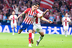 Atletico de Madrid Jose Maria Gimenez and SD Huesca Cucho Hernandez during La Liga match between Atletico de Madrid and SD Huesca at Wanda Metropolitano Stadium in Madrid, Spain. September 25, 2018. (ALTERPHOTOS/Borja B.Hojas)