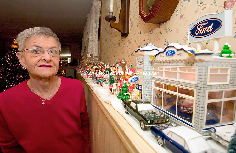 WATERBURY, CT- 30 NOVEMBER 200-113006JS09-Betty Stotz of Waterbury has over 68 Department 56 village buildings along with accessories in her home. One of her favorites is the Ford dealership and the Ford Mustangs. <br /> Jim Shannon/Republican-American
