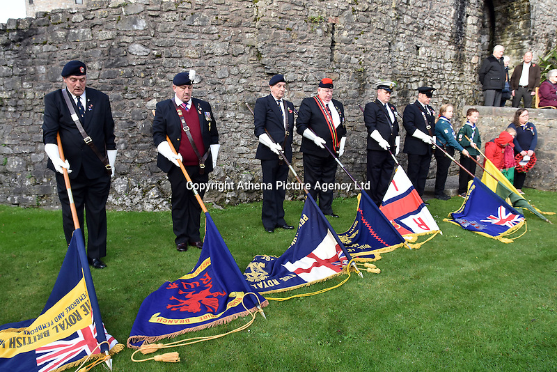 Ex servicemen bring down the flags during Remembrance Day Sunday in Pembroke, west Wales, UK. SUnday 13 November 2016