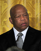 """United States Representative John Lewis (Democrat of Georgia) listens as U.S. President Barack Obama and first lady Michelle Obama honor him and the other recipients of the 2010 Medal of Freedom, """"the Nation's highest civilian honor presented to individuals who have made especially meritorious contributions to the security or national interests of the United States, to world peace, or to cultural or other significant public or private endeavors"""", in a ceremony in the East Room of the White House in Washington, D.C. on Tuesday, February 15, 2011..Credit: Ron Sachs / CNP"""