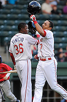 Infielder Mookie Betts (7) of the Greenville Drive, right, is congratulated by Jose Vinicio (36) after hitting a home run in a game against the Lakewood BlueClaws on Wednesday, April 24, 2013, at Fluor Field at the West End in Greenville, South Carolina. Betts was selected by the Boston Red Sox in the 5th Round of the 2011 First-Year Player Draft. Lakewood won, 7-5. (Tom Priddy/Four Seam Images)