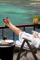 A guest relaxes on a private balcony at the Maia Luxury Resort & Spa