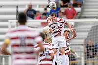 Houston, TX - Friday December 11, 2016: Foster Langsdorf (22) of the Stanford Cardinal heads the ball away from his goal against the Wake Forest Demon Deacons at the NCAA Men's Soccer Finals at BBVA Compass Stadium in Houston Texas.
