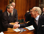 """News Corporation Chairman and CEO Rupert Murdoch shakes hands with United States Senator Michael DeWine (Republican of Ohio) prior to giving testimony before the United States Senate Committee on the Judiciary Subcommittee on Antitrust, Competition, and Business and Consumer Rights on """"The NewsCorp/Direct TV Deal: The Marriage of Content and Global Distribution"""" in Washington, DC on June 18, 2003.."""