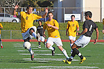 Torrance, CA 01/24/12 - unidentified West Torrance player(s) and Oscar Chacon (Peninsula #8) in action during the Peninsula vs West Torrance CIF Bay league game.