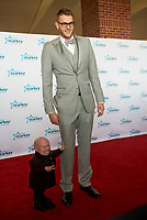 "ST. PAUL, MN JULY 16: Verne Troyer and NBA player Cole Aldrich pose on the red carpet at the Starkey Hearing Foundation ""So The World May Hear Awards Gala"" on July 16, 2017 in St. Paul, Minnesota. Credit: Tony Nelson/Mediapunch"