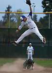 Palo Alto High School at Los Altos High School boys varsity baseball, March 27, 2013.  Palo Alto wins 9-1..6 Shortstop Steven McLean leaps to try to get a wild throw and avoid the sliding runner.