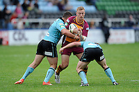 Craig Kopczak of Huddersfield Giants is tackled during the Super League match between Huddersfield Giants and London Broncos at The Twickenham Stoop on Saturday 17th August 2013 (Photo by Rob Munro)