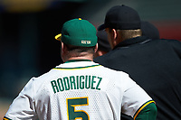 Baylor Bears head coach Steve Rodriguez listens as the home plate umpire Ron Teague explains the ground rules prior to the game against the Missouri Tigers in game one of the 2020 Shriners Hospitals for Children College Classic at Minute Maid Park on February 28, 2020 in Houston, Texas. The Bears defeated the Tigers 4-2. (Brian Westerholt/Four Seam Images)