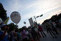"A white balloon with ""No Nukes"" written on it at the Friday night protests outside the Prime Minister's house and in front of the Diet building in Tokyo to protest against nuclear power. Nagatacho Tokyo, Japan. Friday August 10th 2012. Protests have been held every Friday from 6pm to 8pm since March 2012 and participants have been growing in number as Prime Minister Noda carries out his policies of restarting Japan's nuclear reactors. All japan's nuclear reactors were shut down for safety checks after the Fukushima accident on March 11th 2011"