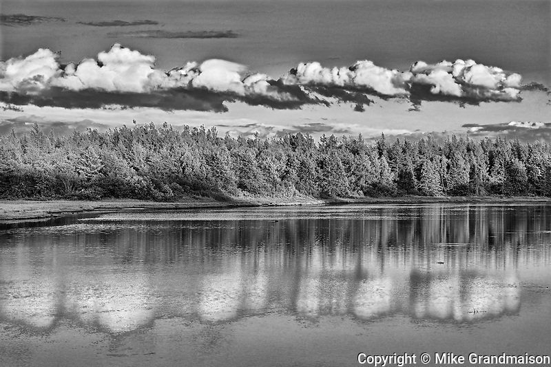 Clouds reflected in an inlet at sunset<br />