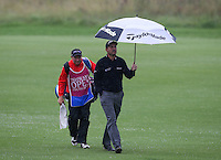 Rain and wind hamper play during the Final Round as David Howell (ENG) walks up the 9th at The Tshwane Open 2014 at the Els (Copperleaf) Golf Club, City of Tshwane, Pretoria, South Africa. Picture:  David Lloyd / www.golffile.ie