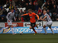 Stuart Armstrong in between Jon Robertson (left) and Jim Goodwin in the St Mirren v Dundee United Clydesdale Bank Scottish Premier League match played at St Mirren Park, Paisley on 27.10.12.