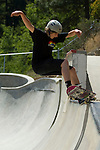 Skateboarders practicing tricks at the skatepark in Jacksonville, Oregon
