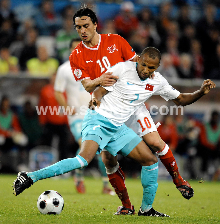 **ALL ROUND PICTURES FROM SOLARPIX.COM**.**SYNDICATION RIGHTS FOR UK AND SPAIN ONLY**.European Championship tournament Euro 2008, Switzerland versus Turkey at St. Jacob-Park, Basel (Switzerland). Turkey 2 Switzerland 1. 11th June 2008..This pic: Hakan Yakin and Mehmet Aurelio..JOB REF: 6618 CPR/Thomas Lohnes .DATE:11_06_2008.**MUST CREDIT SOLARPIX.COM OR DOUBLE FEE WILL BE CHARGED* *UNDER NO CIRCUMSTANCES IS THIS IMAGE TO BE REPRODUCED FOR ANY ONLINE EDITION WITHOUT PRIOR PERMISSION*