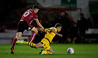 Milton Keynes Dons' Jordan Houghton is fouled by Lincoln City's Conor Coventry<br /> <br /> Photographer Chris Vaughan/CameraSport<br /> <br /> The EFL Sky Bet League One - Lincoln City v Milton Keynes Dons - Tuesday 11th February 2020 - LNER Stadium - Lincoln<br /> <br /> World Copyright © 2020 CameraSport. All rights reserved. 43 Linden Ave. Countesthorpe. Leicester. England. LE8 5PG - Tel: +44 (0) 116 277 4147 - admin@camerasport.com - www.camerasport.com