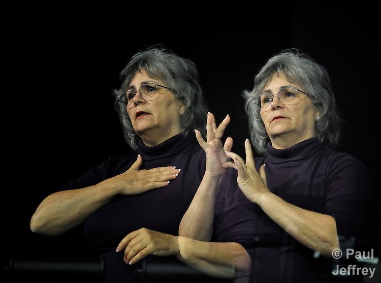 Mary E. Harris provides American Sign Language interpretation at the 2012 United Methodist General Conference in Tampa, Florida. Harris is a member of Conway United Methodist Church in Orlando. This image is a double exposure.