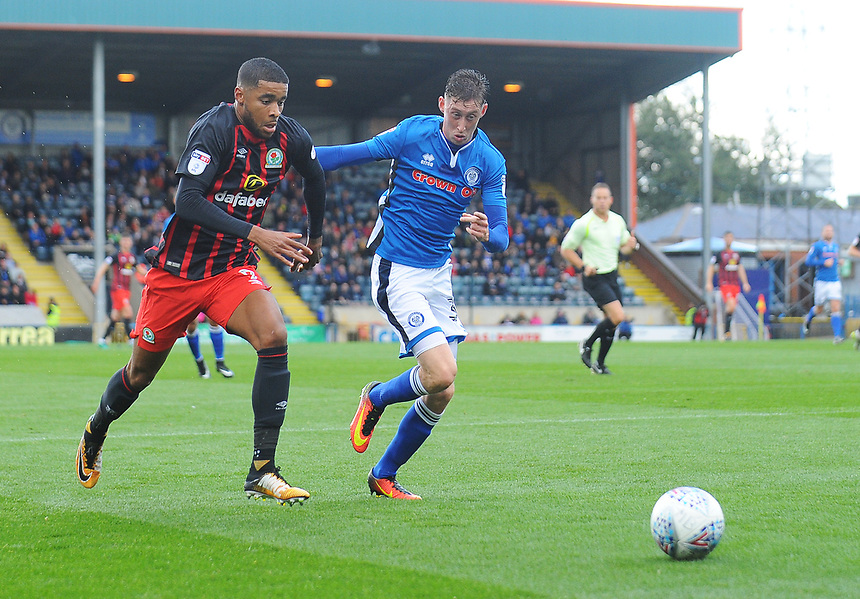 Blackburn Rovers' Dominic Samuel under pressure from Rochdale's Joe Bunney<br /> <br /> Photographer Kevin Barnes/CameraSport<br /> <br /> The EFL Sky Bet League One - Rochdale v Blackburn Rovers - Saturday 9th September 2017 - Spotland Stadium - Rochdale<br /> <br /> World Copyright &copy; 2017 CameraSport. All rights reserved. 43 Linden Ave. Countesthorpe. Leicester. England. LE8 5PG - Tel: +44 (0) 116 277 4147 - admin@camerasport.com - www.camerasport.com