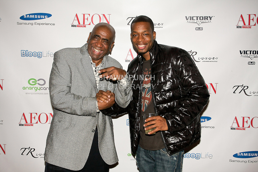 John Blassingame, Publisher of Hype Hair, Black Woman, and Today's Black Men, poses with guest at the Aeon Magazine Launch Party, at the Samsung Experience in the Time Warner Center,  November 15, 2011.