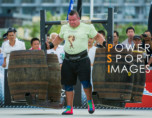 HAINAN ISLAND, CHINA - AUGUST 23:  Mike Jenkins of USA competes at the Super Yoke event during the World's Strongest Man competition at Serenity Marina on August 23, 2013 in Hainan Island, China.  Photo by Victor Fraile