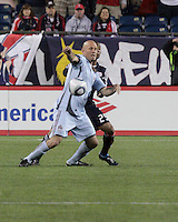 Colorado Rapids forward Conor Casey (9) beats New England Revolution defender Darrius Barnes (25) to the ball.  The Colorado Rapids defeated the New England Revolution, 2-1, at Gillette Stadium on April 24.2010