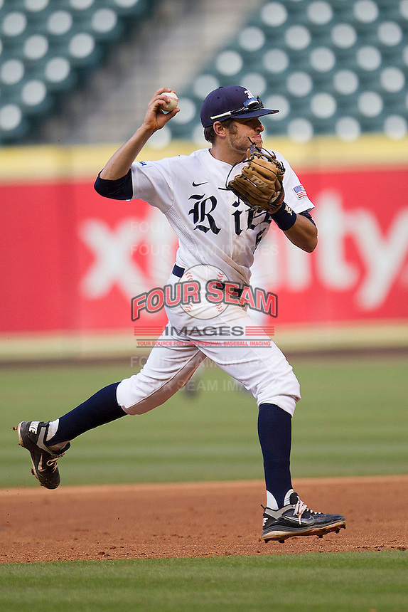 Rice Owls shortstop Ford Stainback #11 prepares to throw the ball to first base during the NCAA baseball game against the North Carolina Tar Heels on March 1st, 2013 at Minute Maid Park in Houston, Texas. North Carolina defeated Rice 2-1. (Andrew Woolley/Four Seam Images).
