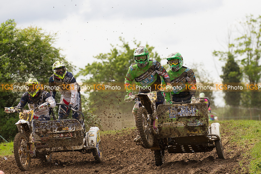 Tilo Maguire and Ben White (32) land alongside Tom and Andy Smith (31) during ACU British Sidecar Cross Championship Round Three at Wattisfield Hall MX Track on 22nd May 2016