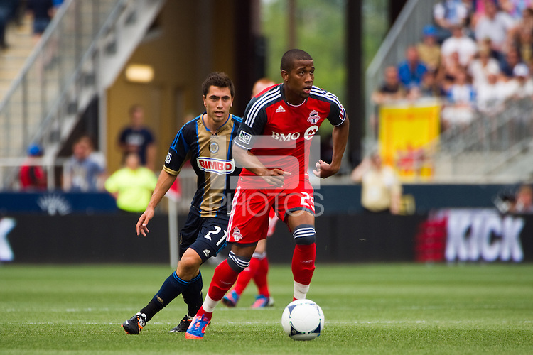 Jeremy Hall (25) of Toronto FC is trailed by Michael Farfan (21) of the Philadelphia Union. The Philadelphia Union defeated Toronto FC 3-0 during a Major League Soccer (MLS) match at PPL Park in Chester, PA, on July 8, 2012.