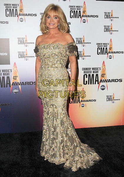 BARBARA MANDRELL.Attending the 43rd Annual CMA Awards held at the Sommet Center, Nashville, Tennessee, USA, 11th November 2008..pressroom press room country music .full length gold dress off the shoulders long maxi embroidered pattern .CAP/ADM/GS.©George Shepherd/AdMedia/Capital Pictures.