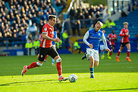 Barnsley's midfielder Adam Hammill (7) chased by Sheffield Wednesday's midfielder Barry Bannan (10) during the Sky Bet Championship match between Sheff Wednesday and Barnsley at Hillsborough, Sheffield, England on 28 October 2017. Photo by Stephen Buckley / PRiME Media Images.