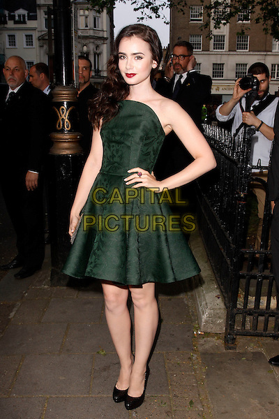 Lily Collins.Arrivals at the Glamour Women Of The Year Awards, Berkeley Square Gardens, London, England..May 29th, 2012.full length green strapless dress hand on hip.CAP/AH.©Adam Houghton/Capital Pictures.