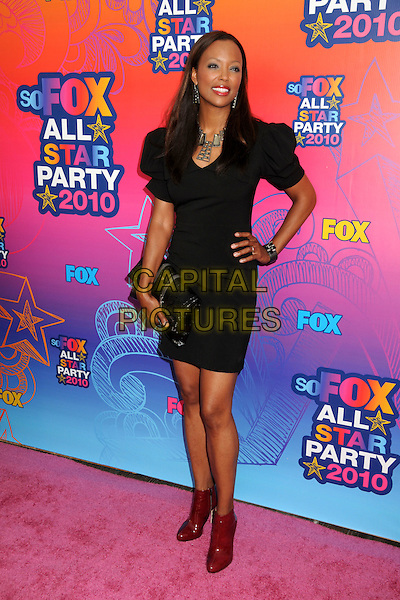 AISHA TYLER.FOX 2010 Summer TCA All-Star Party held at Pacific Park on the Santa Monica Pier, Santa Monica, California, USA..August 2nd, 2010.full length black dress hand on hip clutch bag red patent ankle boots shoes.CAP/ADM/BP.©Byron Purvis/AdMedia/Capital Pictures.