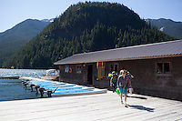 Backpackers make their way towards the main office at the Ross Lake Resort, a floatilla on the Ross Lake Reservoir, Ross Lake, WA, USA.