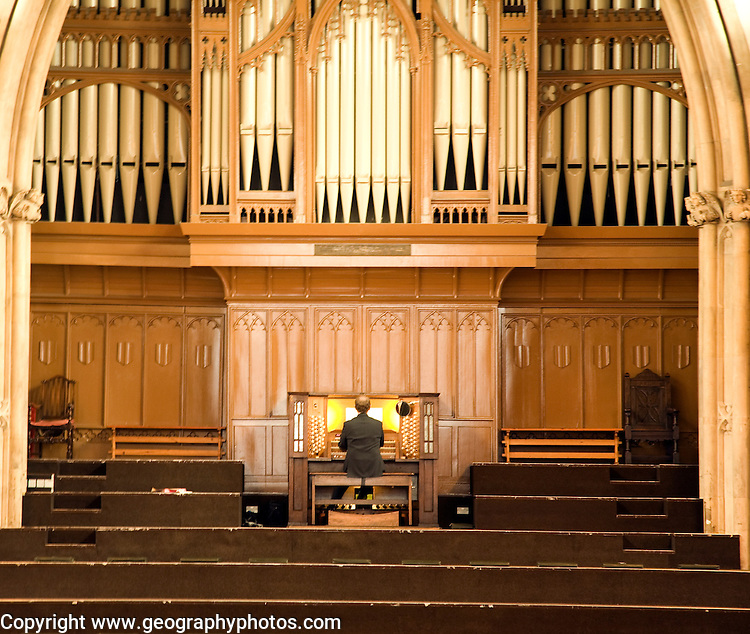 Man playing organ, St Andrews Hall, Norwich, Norfolk, England