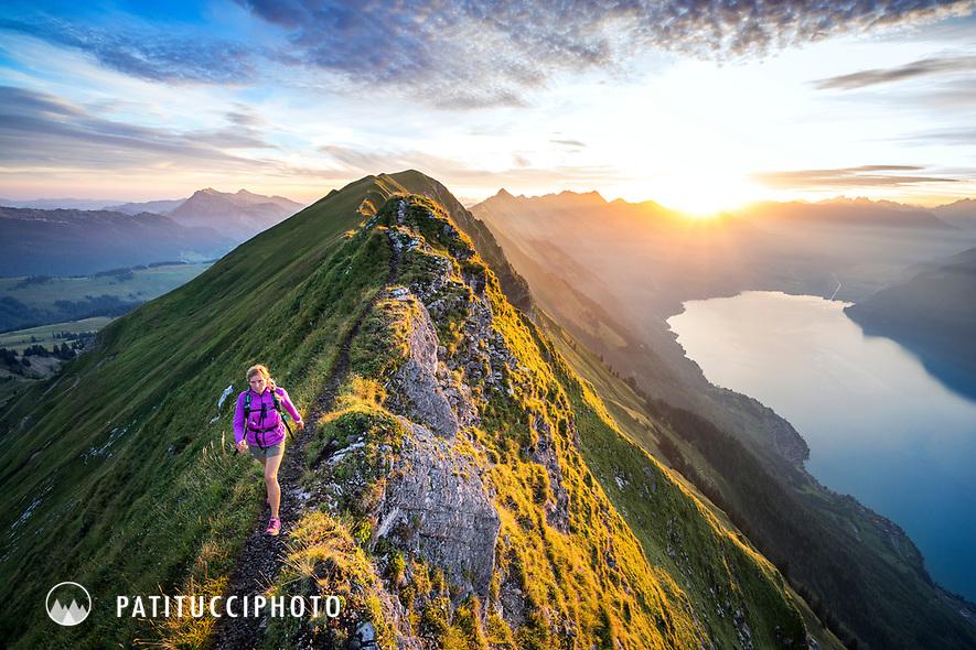 Hiking at sunrise on the famous Hardergrat, aka Brienzergrat, a long ridgeline above the Brienzersee connecting Interlaken with Brienz, Switzerland
