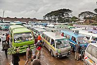 Matatus line up to collect passengers in the busy Railways terminus in Nairobi, Kenya.