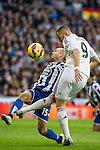 Real Madrid´s Karim Benzema and Deportivo de la Coruna's Laureano Sanabria Ruiz during 2014-15 La Liga match between Real Madrid and Deportivo de la Coruna at Santiago Bernabeu stadium in Madrid, Spain. February 14, 2015. (ALTERPHOTOS/Luis Fernandez)