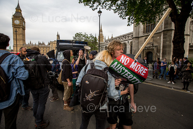 London, 27/05/2015. Today, with the traditional Queen's Speech in the Houses of Parliament the new British Government is officially formed and the Parliament opened (&lt;&lt;The State Opening of Parliament marks the formal start of the parliamentary year and the Queen's Speech sets out the government's agenda for the coming session, outlining proposed policies and legislation. It is the only regular occasion when the three constituent parts of Parliament - the Sovereign, the House of Lords and the House of Commons - meet. [&hellip;]&gt;&gt; - sourse http://www.parliament.uk/). In the afternoon, after the Queen and the other members of the British Royal Family left the Parliament to return to Buckingham Palace, a demonstration and a march were held in Central London against the British Government austerity measures, cuts, privatizations and policies planned for the next five years.<br />