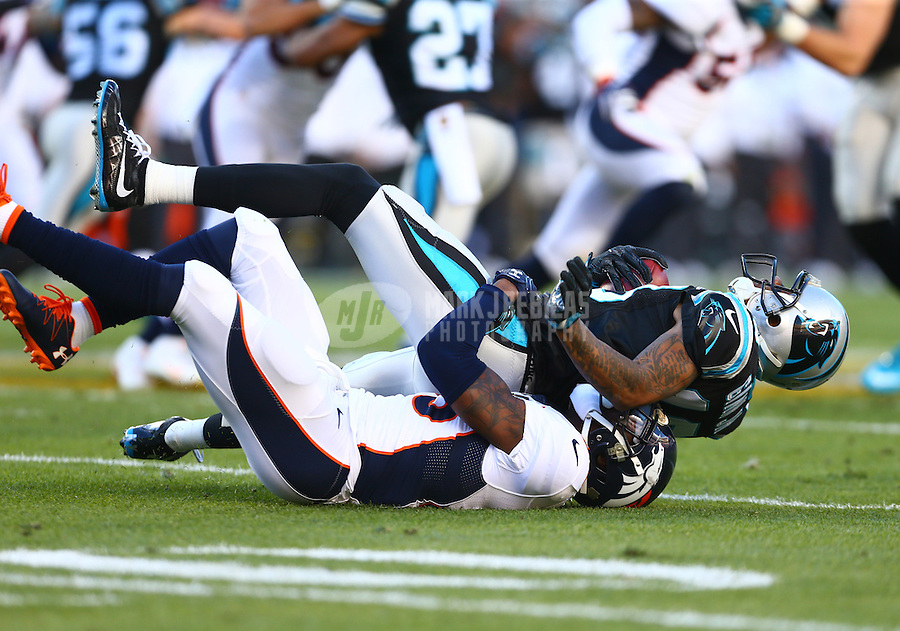 Feb 7, 2016; Santa Clara, CA, USA; Carolina Panthers wide receiver Ted Ginn Jr. (top) is tackled by Denver Broncos cornerback Kayvon Webster in Super Bowl 50 at Levi's Stadium. Mandatory Credit: Mark J. Rebilas-USA TODAY Sports