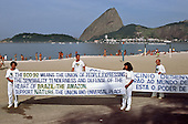 United Nations Conference on Environment and Development, Rio de Janeiro, Brazil, 3rd to 14th June 1992. Group dressed in white with banngers in English and Portuguese on the beach at Flamengo, at the Global Forum.