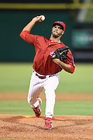 Clearwater Threshers relief pitcher Miguel Alfredo Gonzalez (48) delivers a warmup pitch during a game against the Tampa Yankees on June 26, 2014 at Bright House Field in Clearwater, Florida.  Clearwater defeated Tampa 4-3.  (Mike Janes/Four Seam Images)