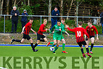 Kerry U17's Nathan Gleeson attempting to get forward as  Evan Connolly of Carlow/Kilkenny is about to close him down, in the League of Ireland in Mounthawk Park on Sunday.
