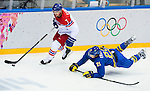 (R) Tamos Kaberle of Czech Republic competes for the puck (L) Loui Eriksson of Sweden during the match between Sweden vs Czech Republic during their Men's Ice Hockey Preliminary Round Group C game on day five of the 2014 Sochi Olympic Winter Games at Bolshoy Ice Dome on February 12, 2014 in Sochi, Russia. Photo by Victor Fraile / Power Sport Images