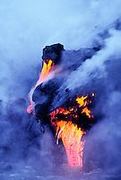 Kilauea lava flowing into the ocean at Hawaii volcanoes national park.