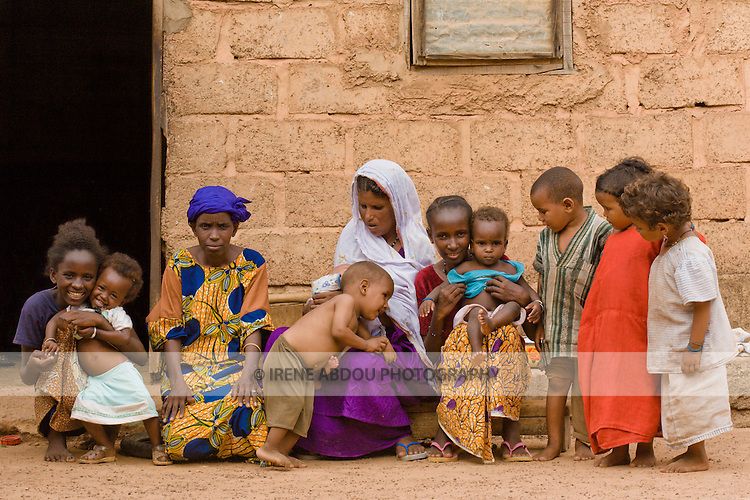 A group of Touareg and Fulani women and children excitedly group together in anticipation of this photo in Ouagadougou, Burkina Faso.