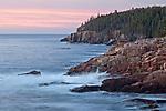 Long-exposure of waves meeting the rocky granite coastline at sunrise along Ocean Drive/Park Loop Road on Mount Desert Island in Acadia National Park, Maine