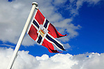 National flag flying on post ship Hurtigruten ferry, Norway