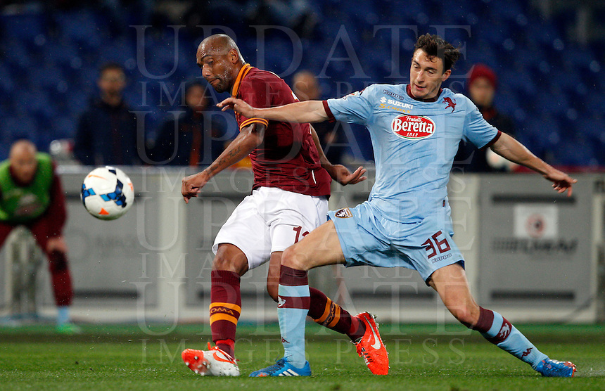 Calcio, Serie A: Roma vs Torino. Roma, stadio Olimpico, 25 marzo 2014.<br /> AS Roma defender Maicon, of Brazil, is challenged by Torino defender Matteo Darmian, right, during the Italian Serie A football match between AS Roma and Torino at Rome's Olympic stadium, 25 March 2014.<br /> UPDATE IMAGES PRESS/Riccardo De Luca